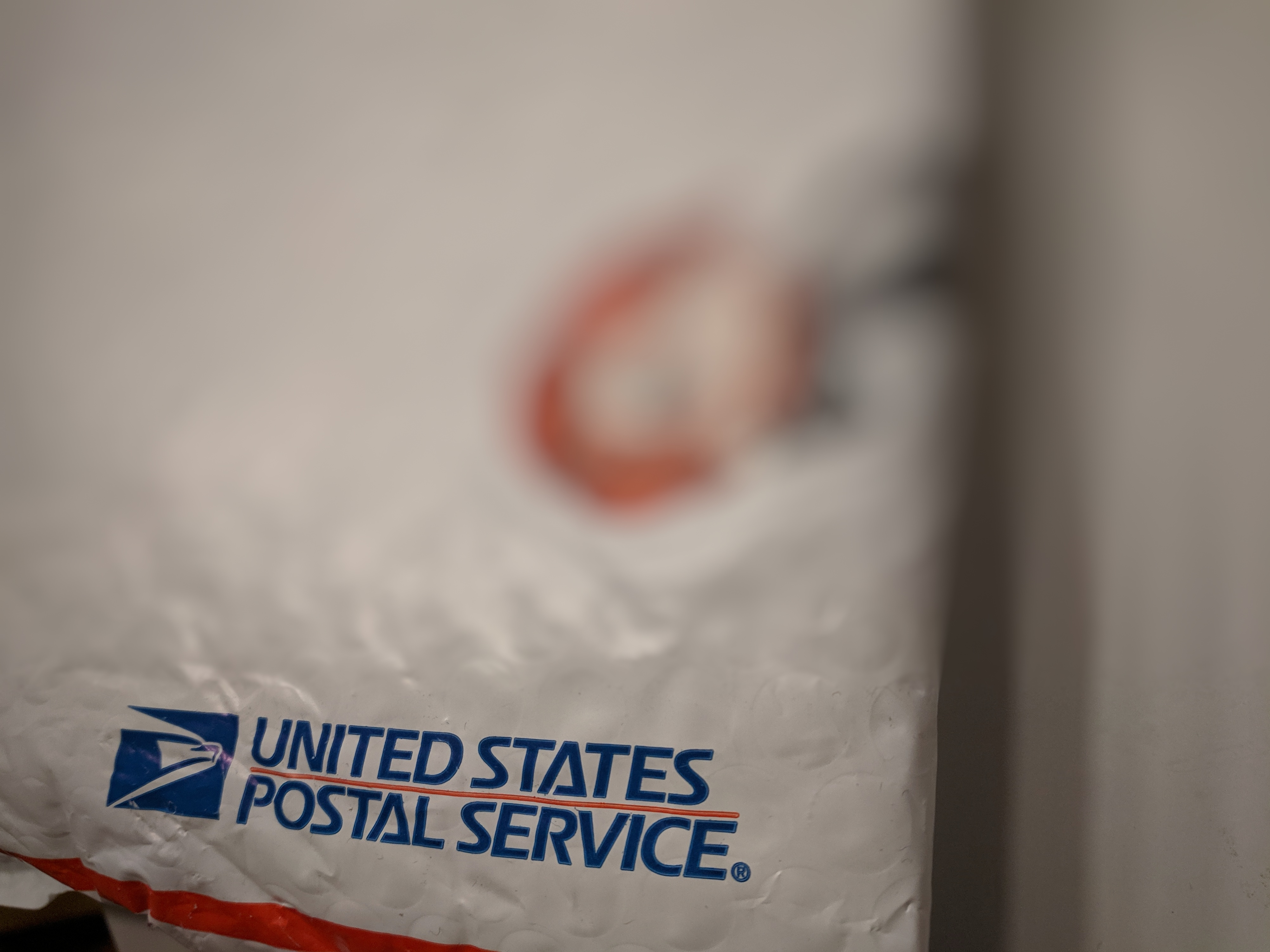 Blurry image of a USPS package