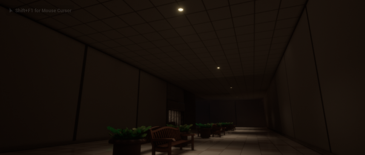 Dim hallway screenshot in-game with some benches and plants in the center of the hall