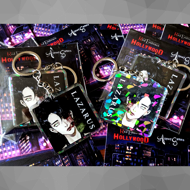 store image of the lazarus 2 inch acrylic keychain. front on left with epoxy coating and on the right is the back with broken mirror holographic layer